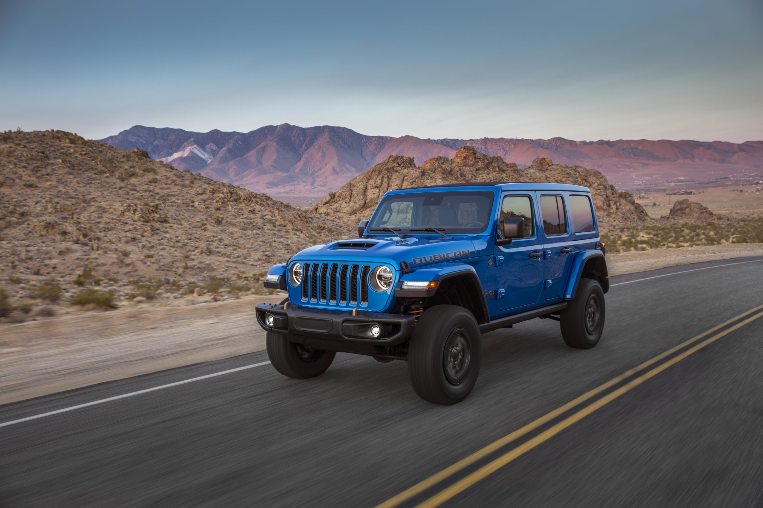 2021 Jeep Wrangler Rubicon 392 blue on road front three quarter