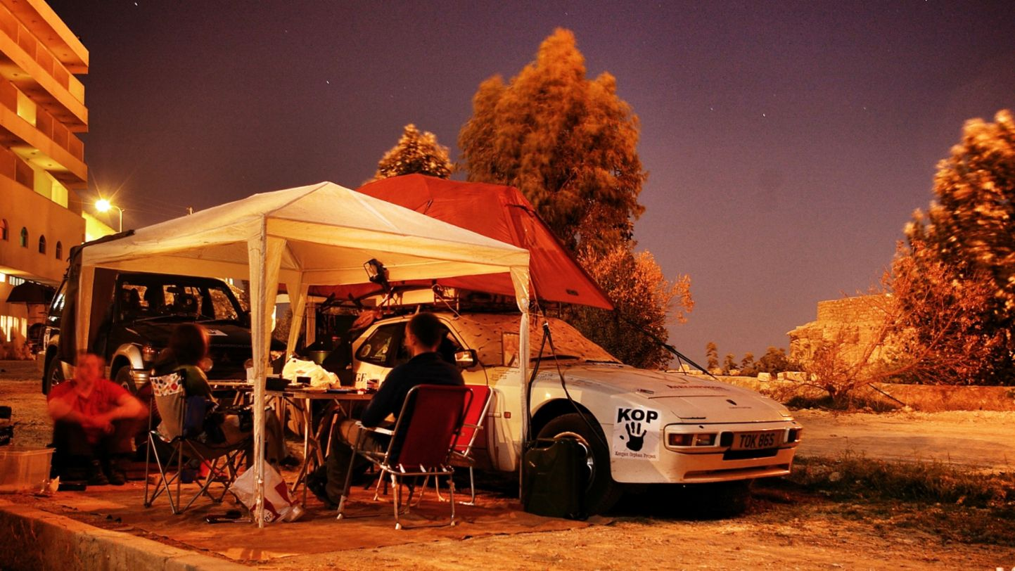 Africa Porsche 944 tent popped resting at night