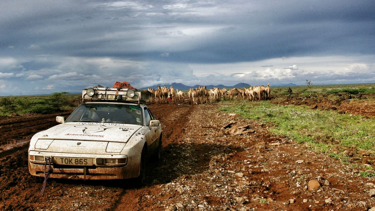 Africa Porsche 944 mud, camels, and car