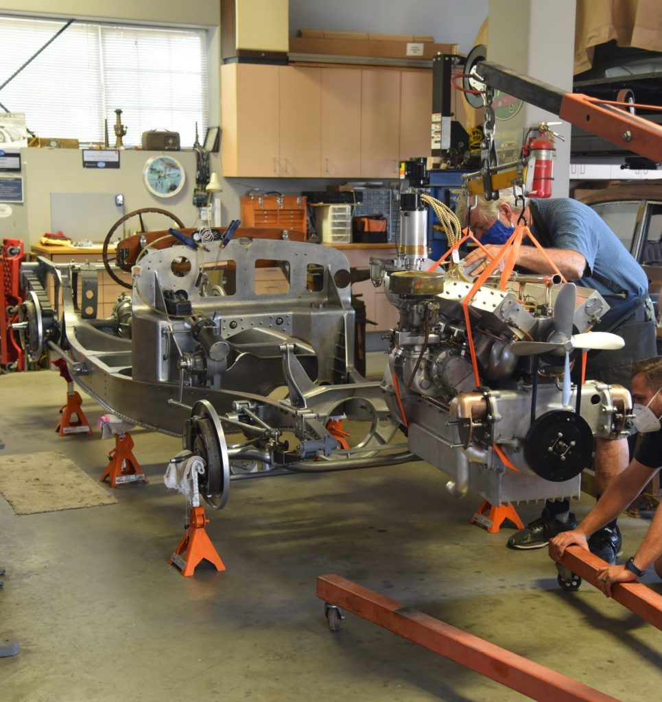 3.3-liter Bugatti straight-eight moving into place