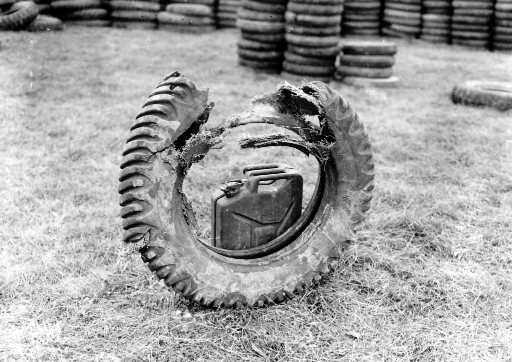 Jerrycan inside rotted old tire
