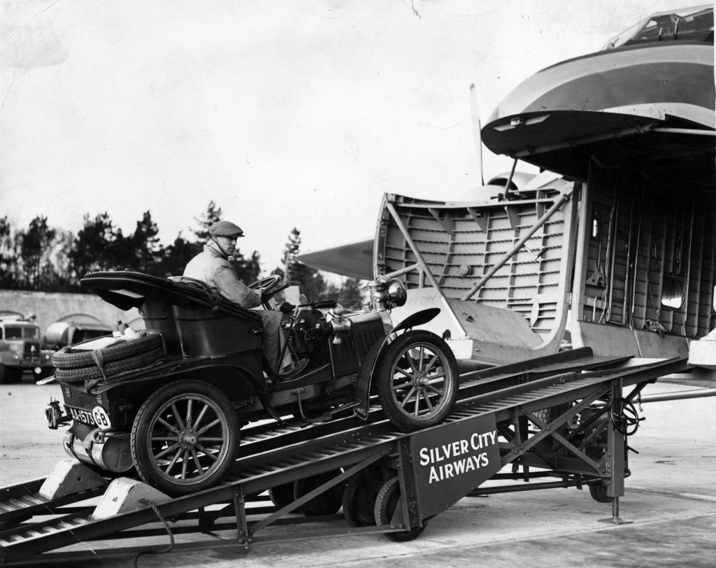 Old motor car being loaded on to Silver City Airways aeroplane
