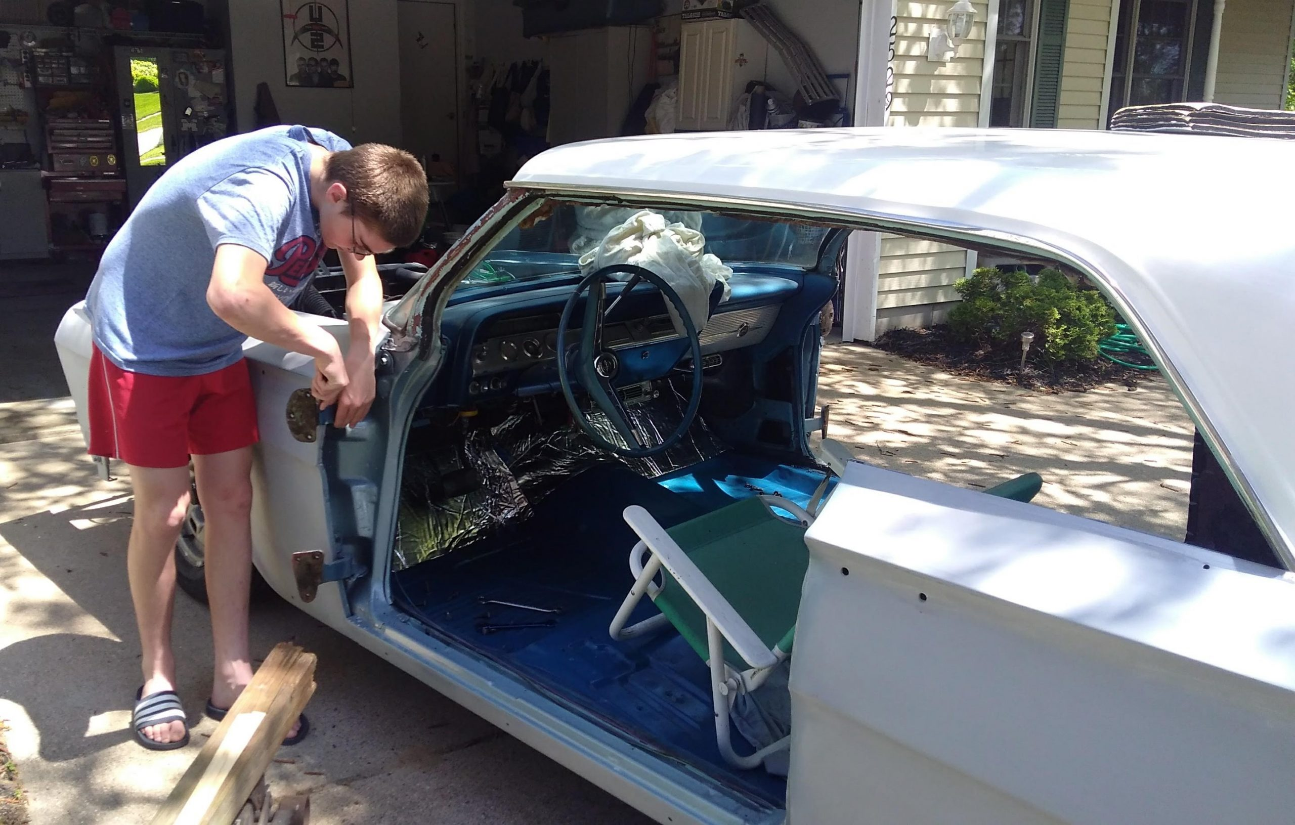 Jason Prince - 1962 Chevrolet Impala - Before resto - Noah working on door