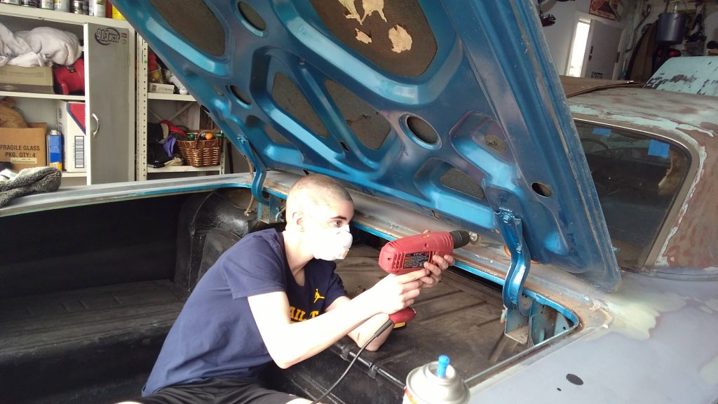 Jason Prince - 1962 Chevrolet Impala - Before resto - Noah working on trunk