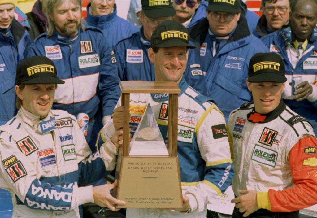 Jim Pace holding daytona 24 trophy