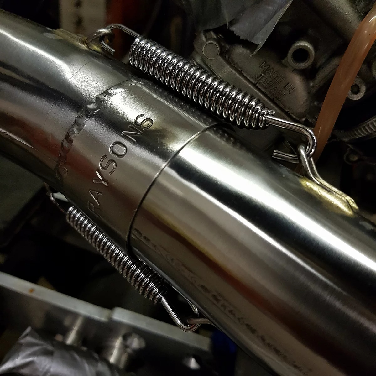 raysons exhausts workshop signature etch