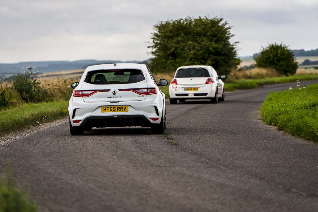 Renault Megane R26R and Trophy R together country road action rear