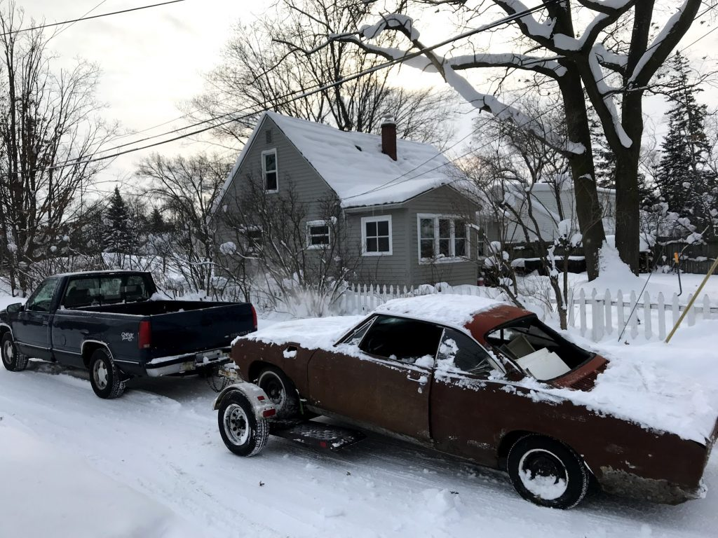 1965 Chevrolet Corvair getting hauled off for scrap