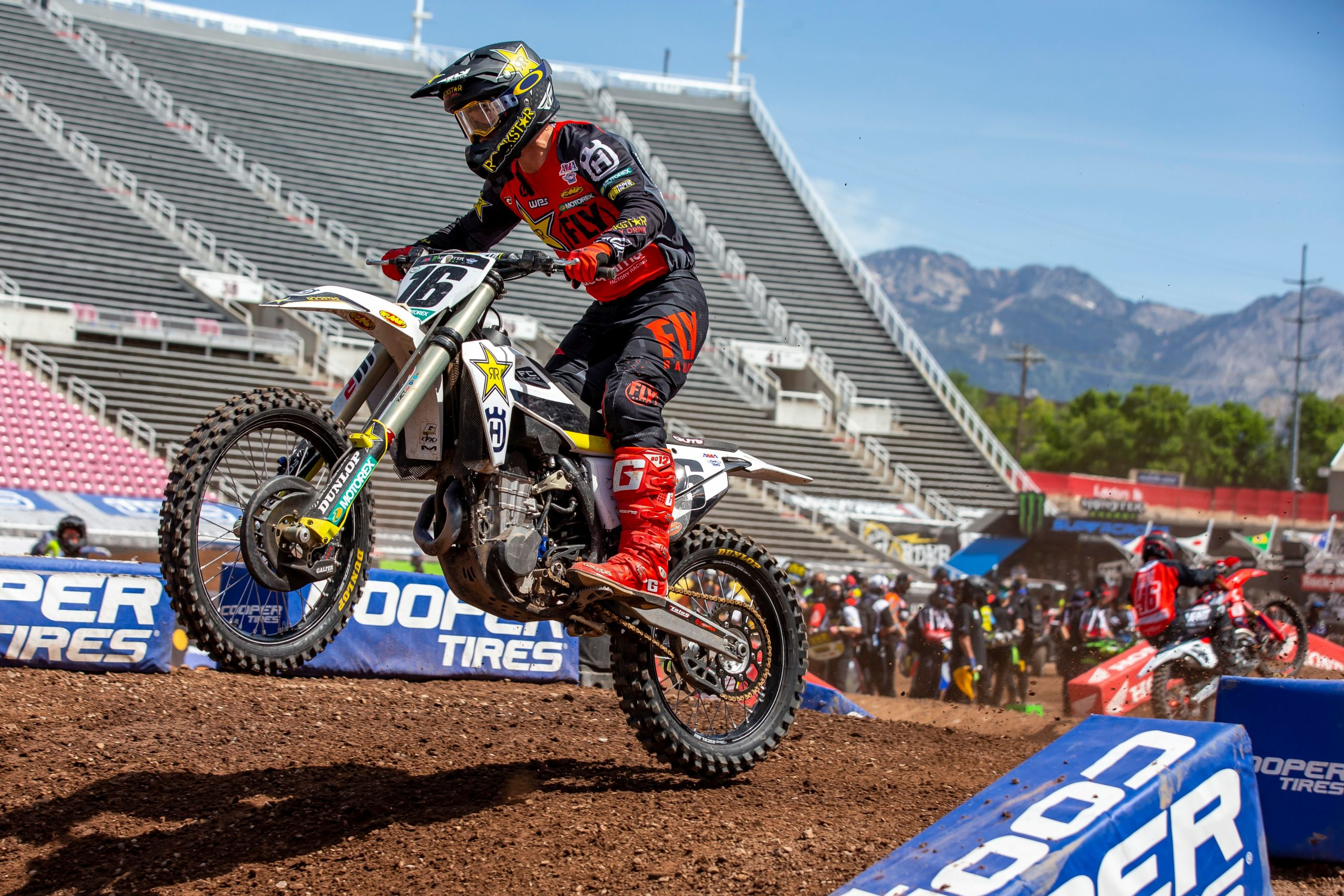 Supercross rider over dirt table action