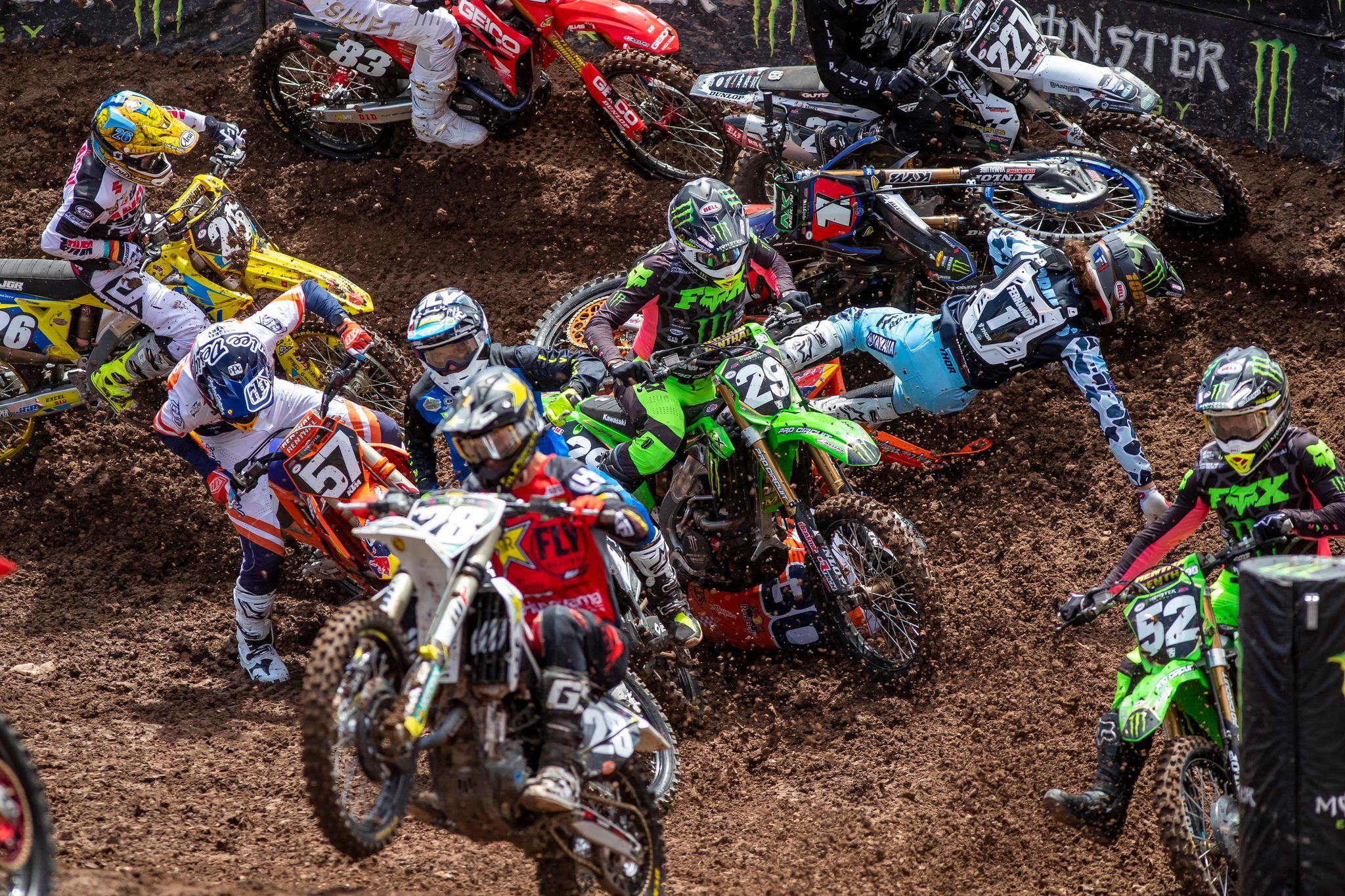 Supercross riders cornering crash pile up action