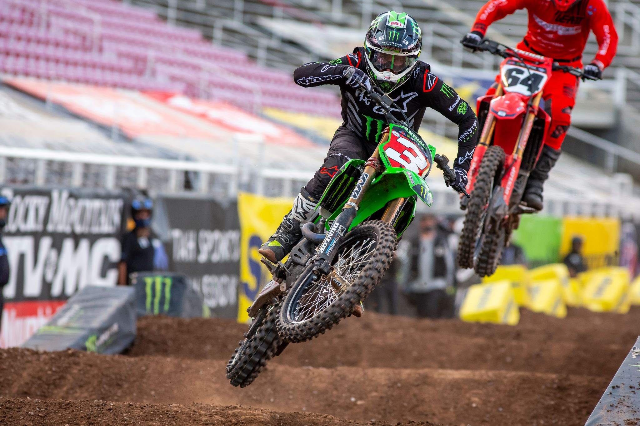Supercross riders over jump section action