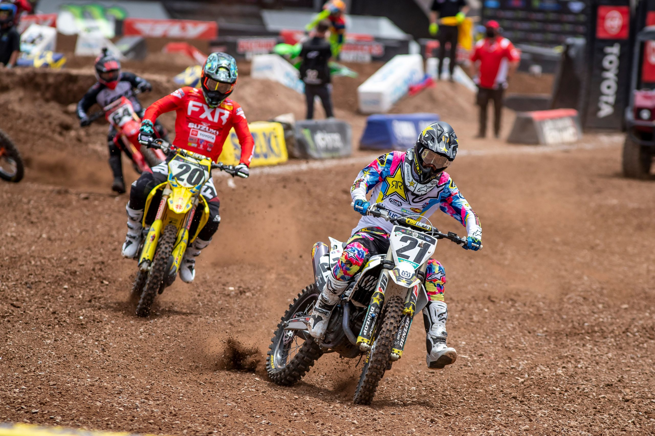 Supercross riders skidding on track action