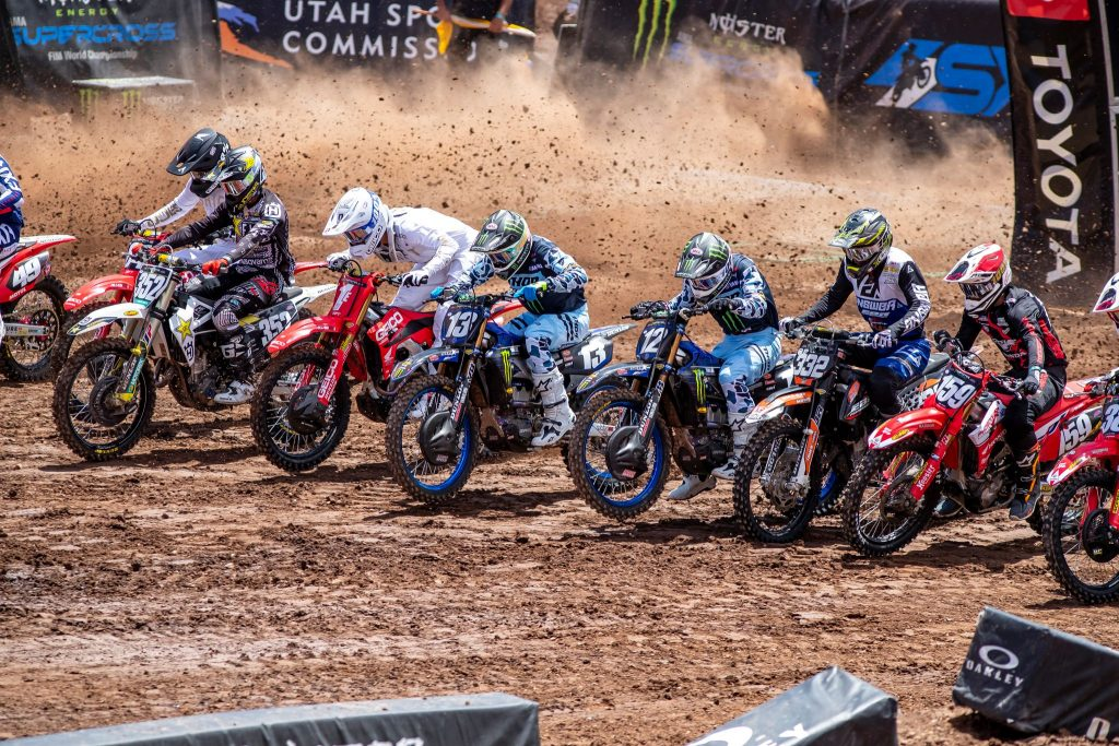 Supercross riders shoot from starting gates action