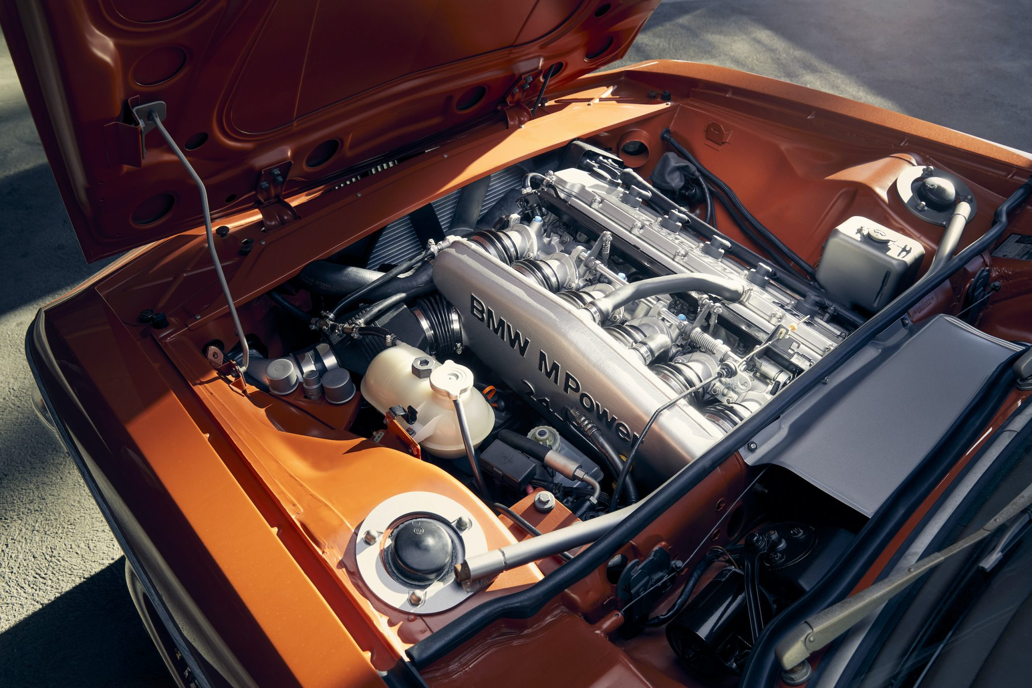 Standing in for the stock 3.0-liter inline-six is the later S38 3.5-liter six from the 1988–1995 BMW M5. This 311-hp crooner has more than 100 ponies on the original mill—and makes lovely engine-room jewelry. Joseph Puhy
