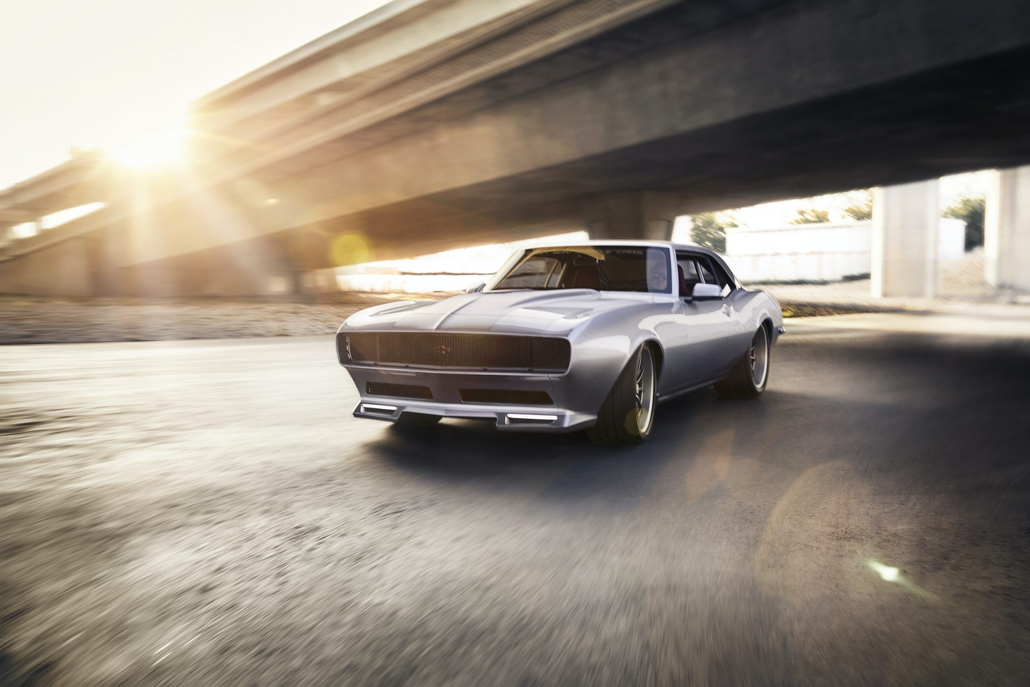 It's still clearly a 1968 Camaro, but East Bay Muscle Cars widened the body 5 inches, added custom rockers, flush-mounted the windshield, and reshaped the hood and fenders with more pronounced peaks. Joseph Puhy
