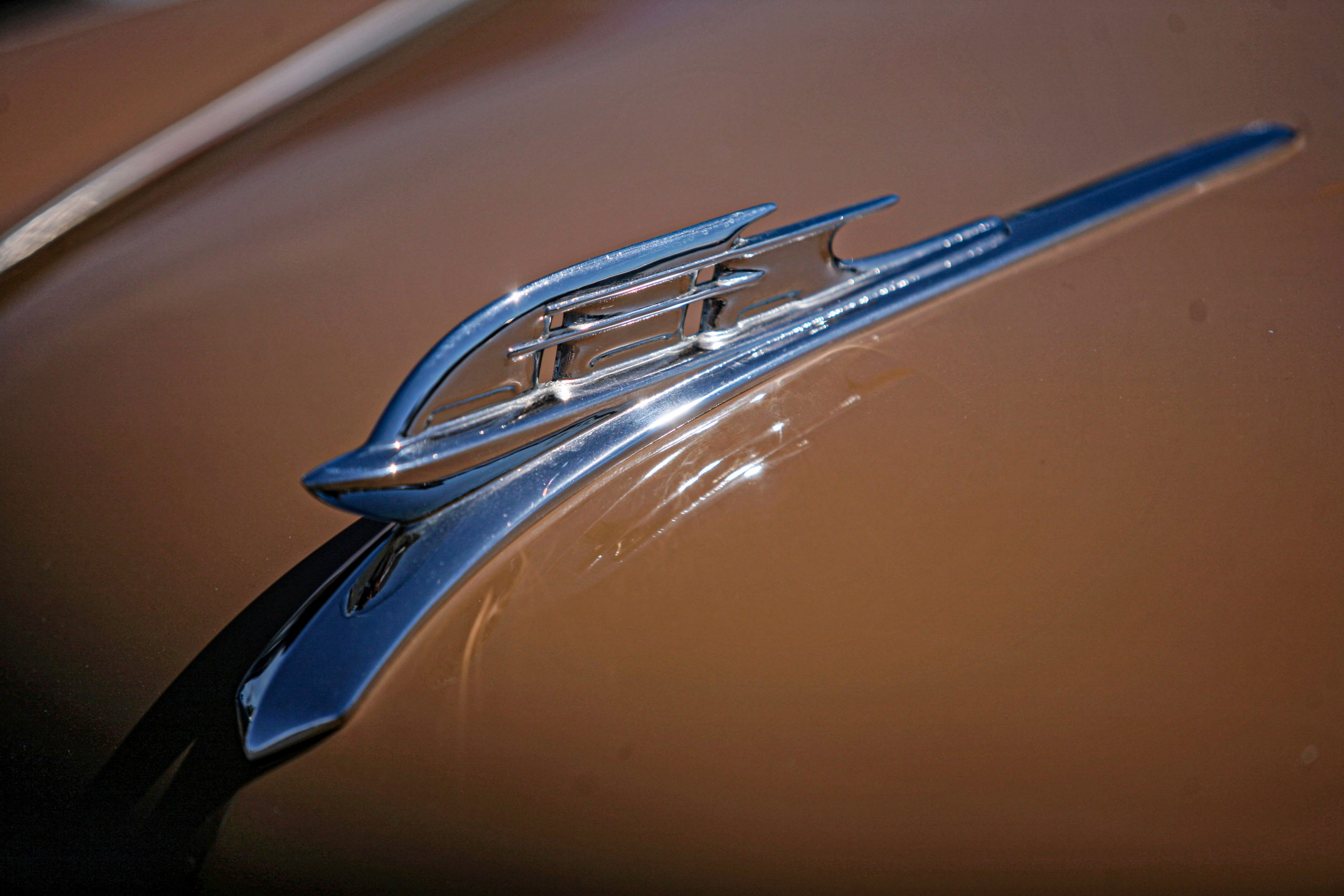 1953 Plymouth Hood Ornament Brown