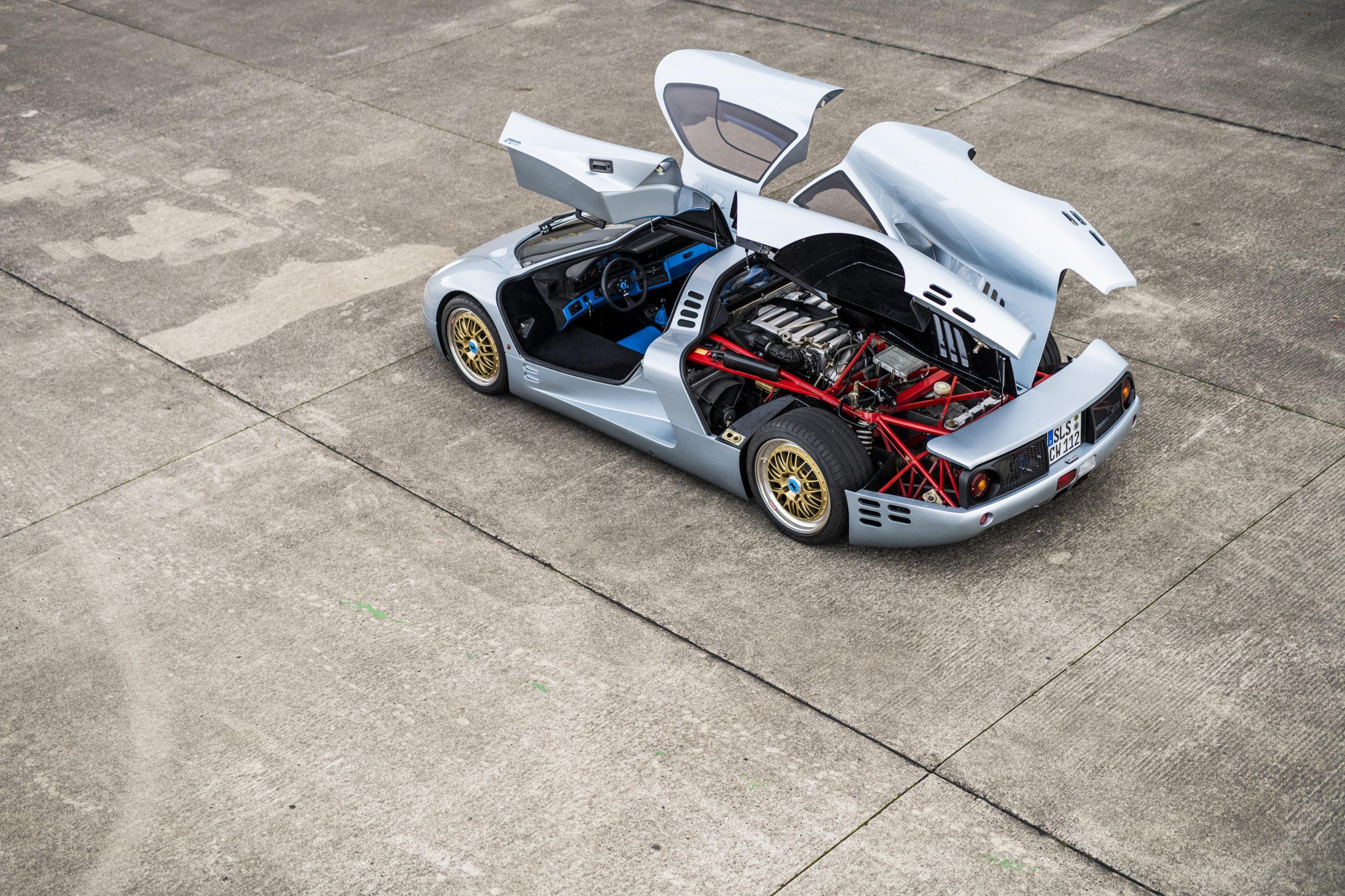 1993 Isdera Commendatore 112i rear three-quarter doors up panels open