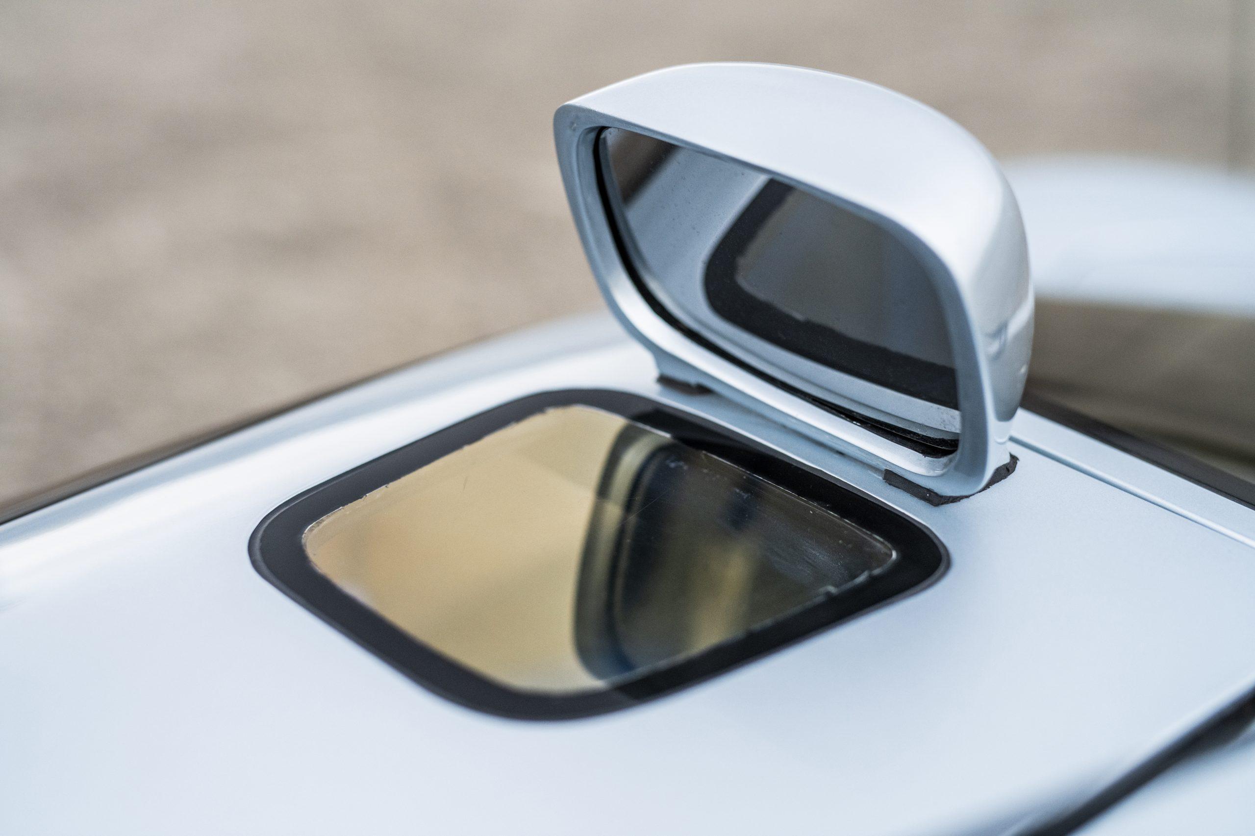 1993 Isdera Commendatore 112i rear mirror glass detail
