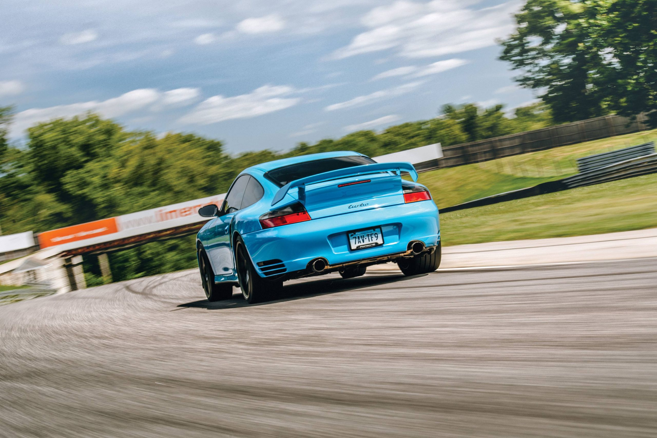 porsche 911 turbo rear three-quarter dynamic action
