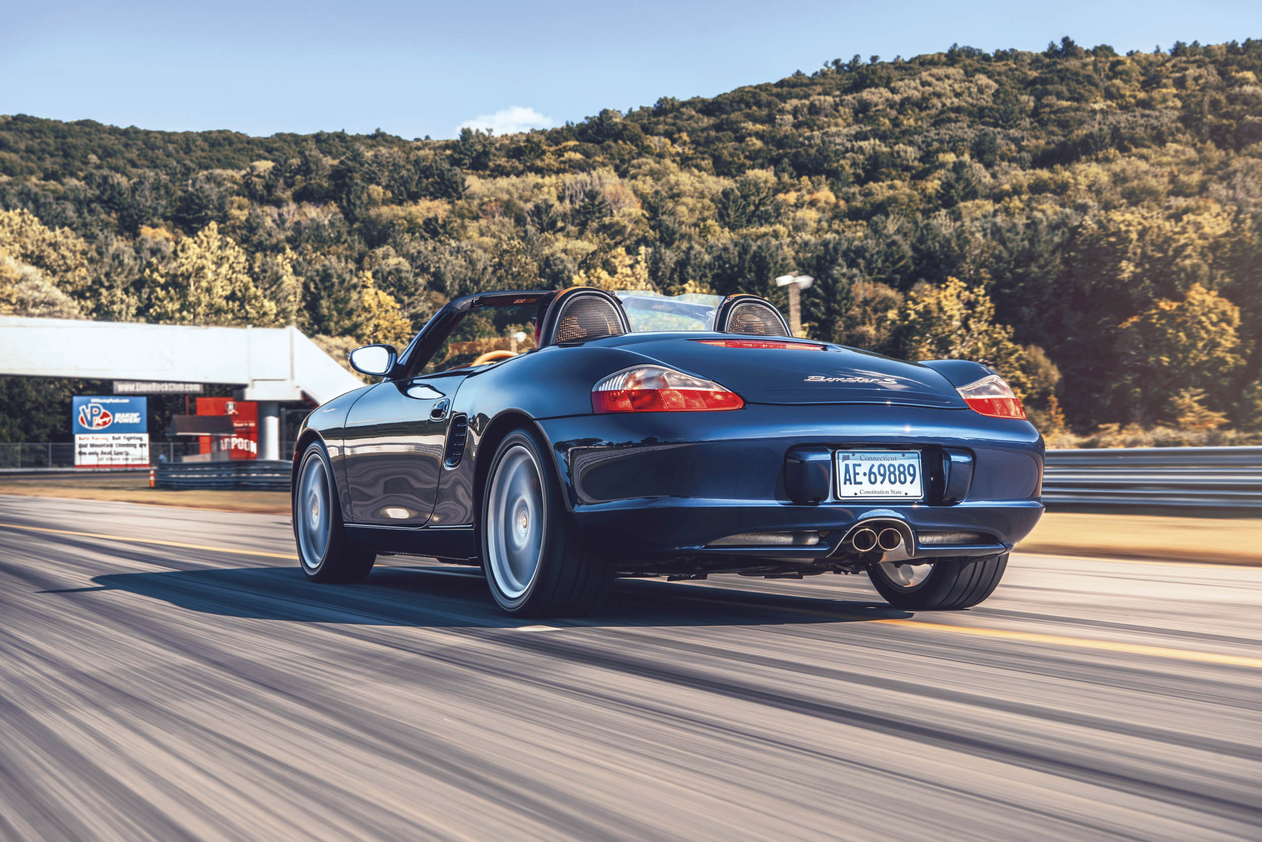 porsche boxster rear three-quarter dynamic action