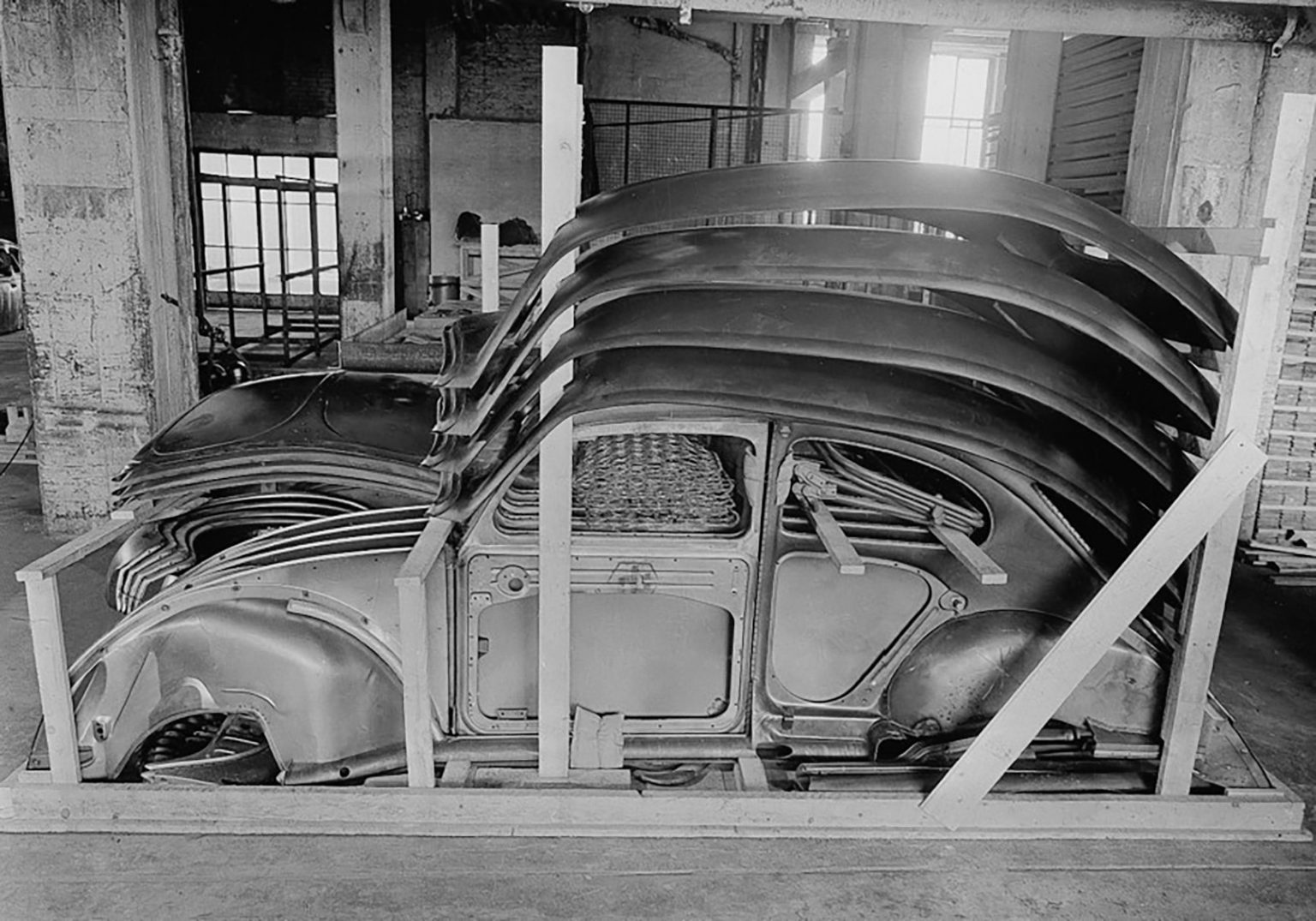 Beetles in boxes body panels stacked