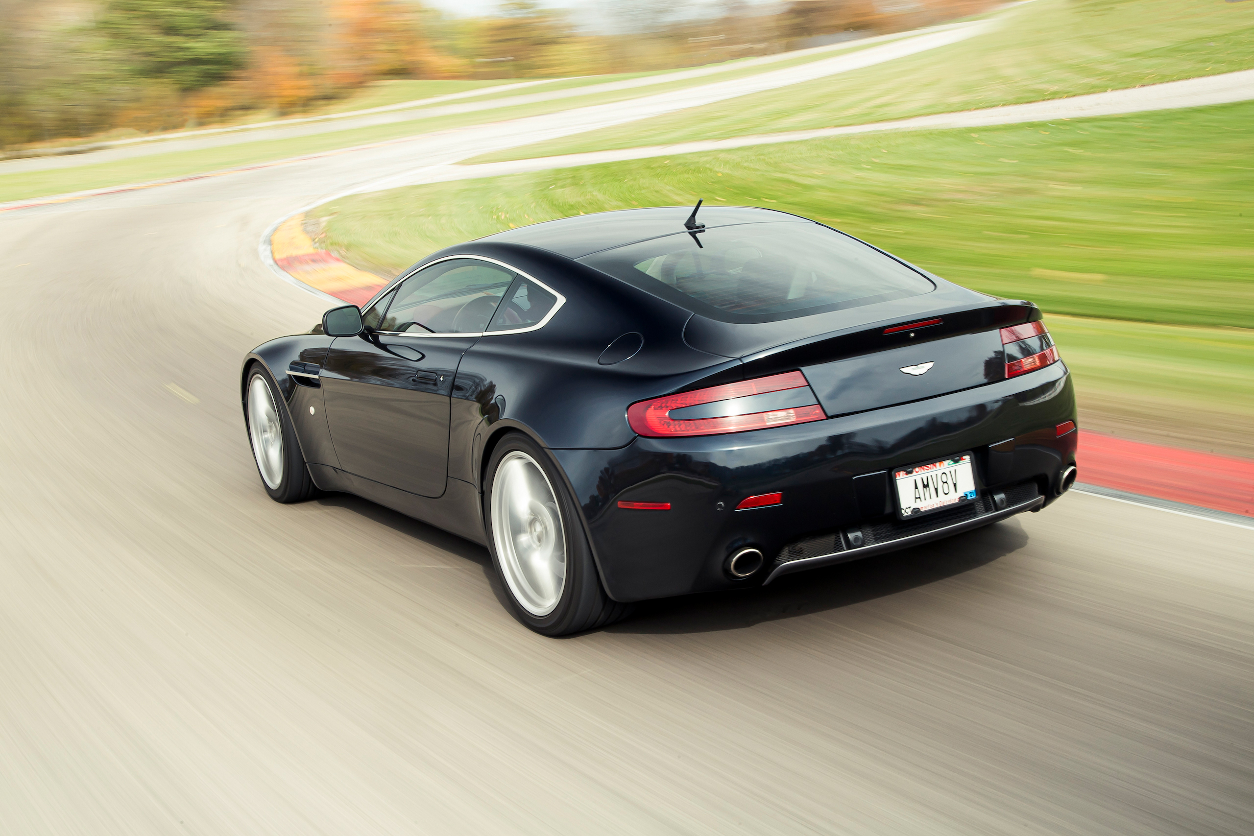 Aston Martin Vantage rear three-quarter dynamic on track action