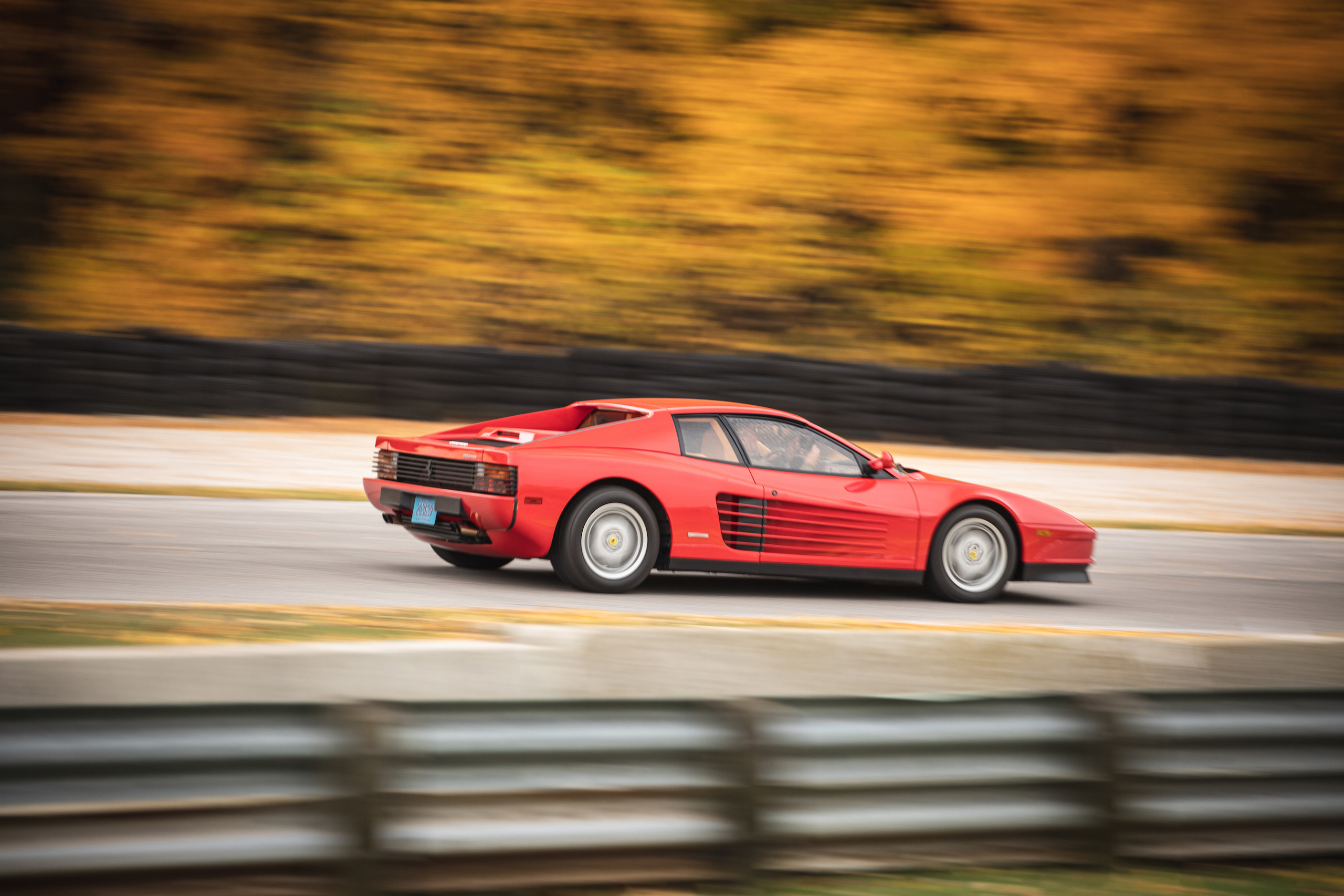 Ferrari Testarossa rear three-quarter dynamic on track action