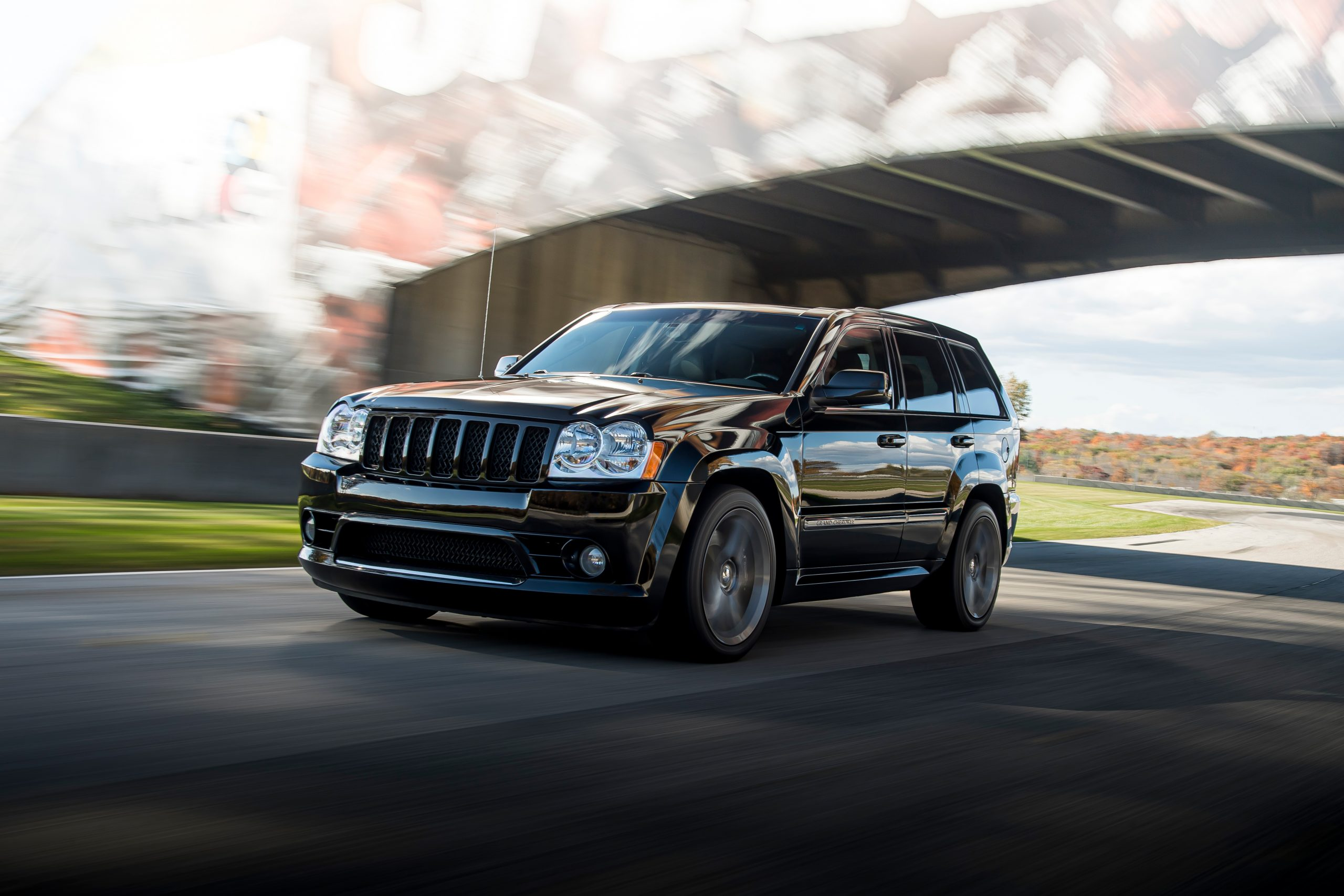 Jeep Grand Cherokee SRT8 front three-quarter dynamic on track action
