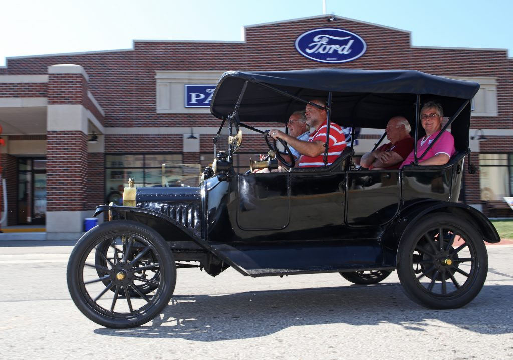Ford Model T students driving side profile action