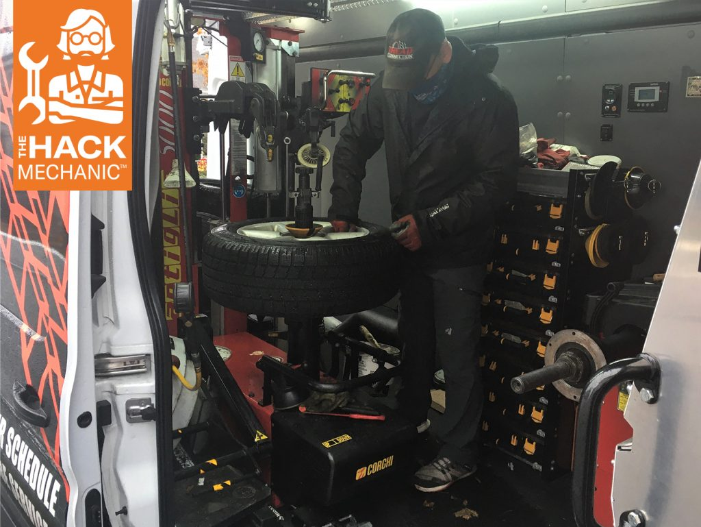 driveway tire service tech mechanic mounts tire