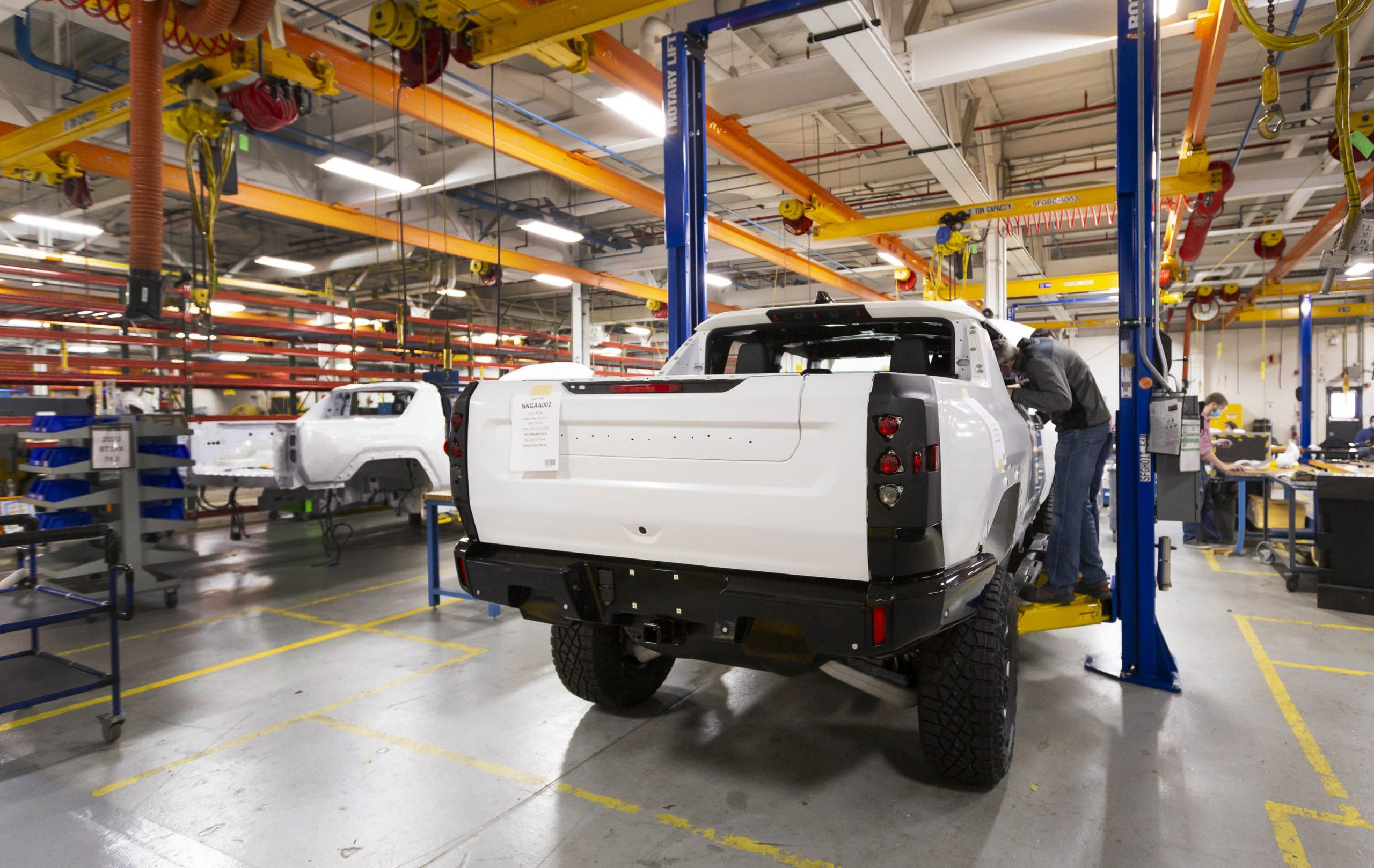 Two GMC HUMMER EVs completing their builds prior to shipping