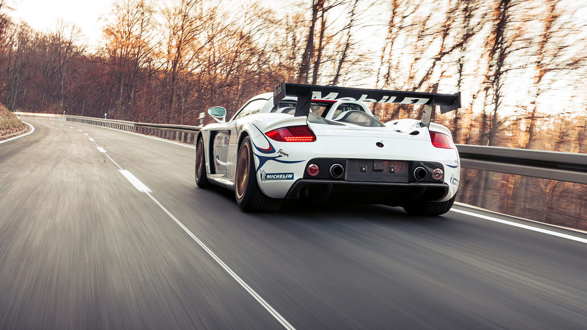 Carrera GT Racecar rear three-quarter dynamic action
