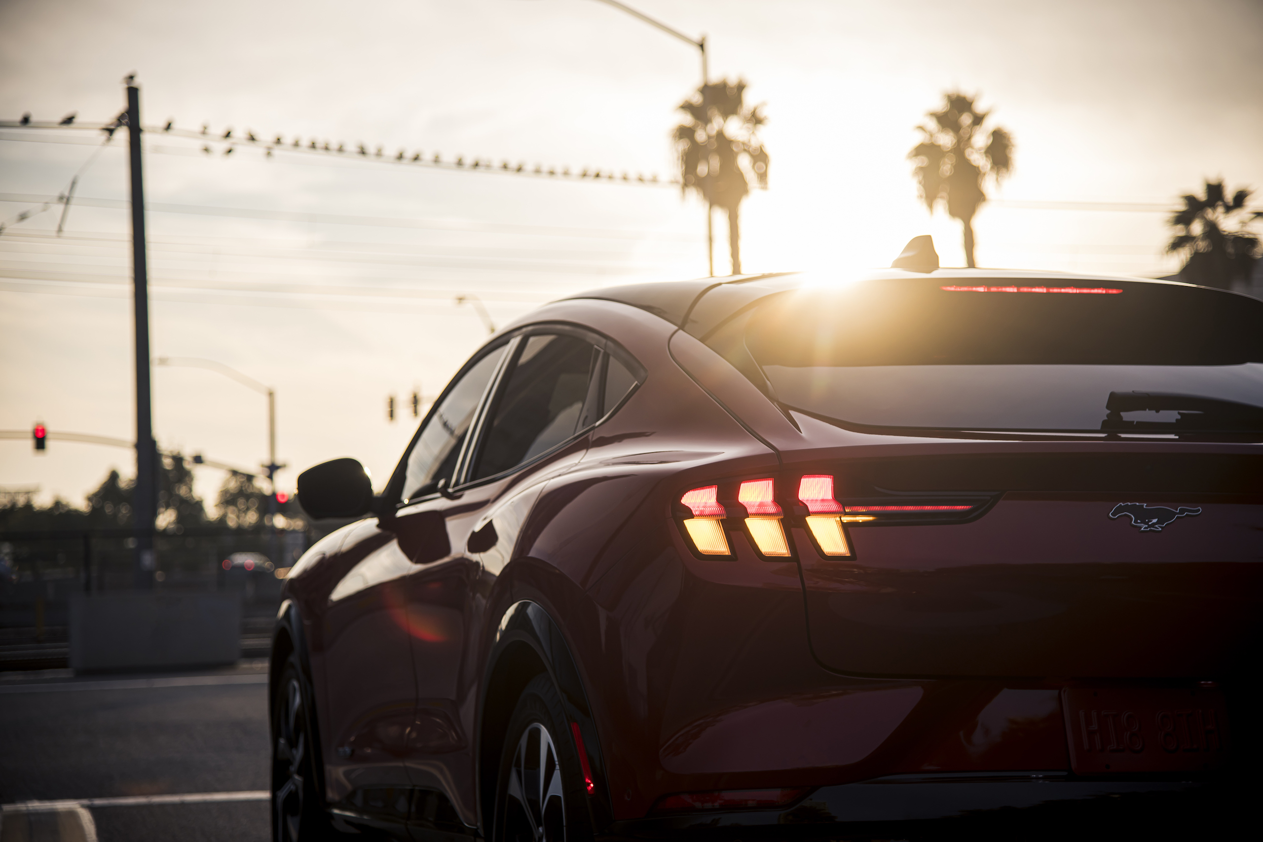 Mustang Mach-E rear three-quarter close at sunset