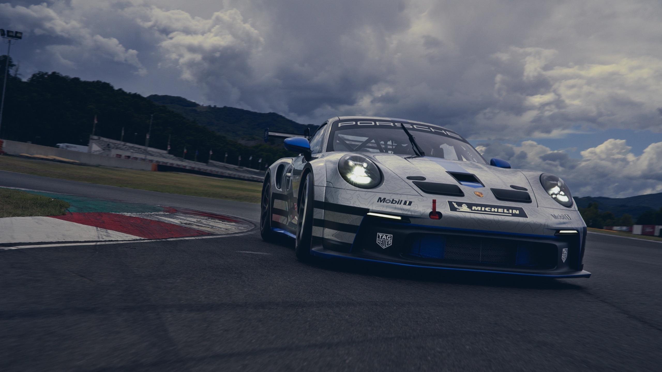 Porsche 911 GT3 front three-quarter dynamic action cornering