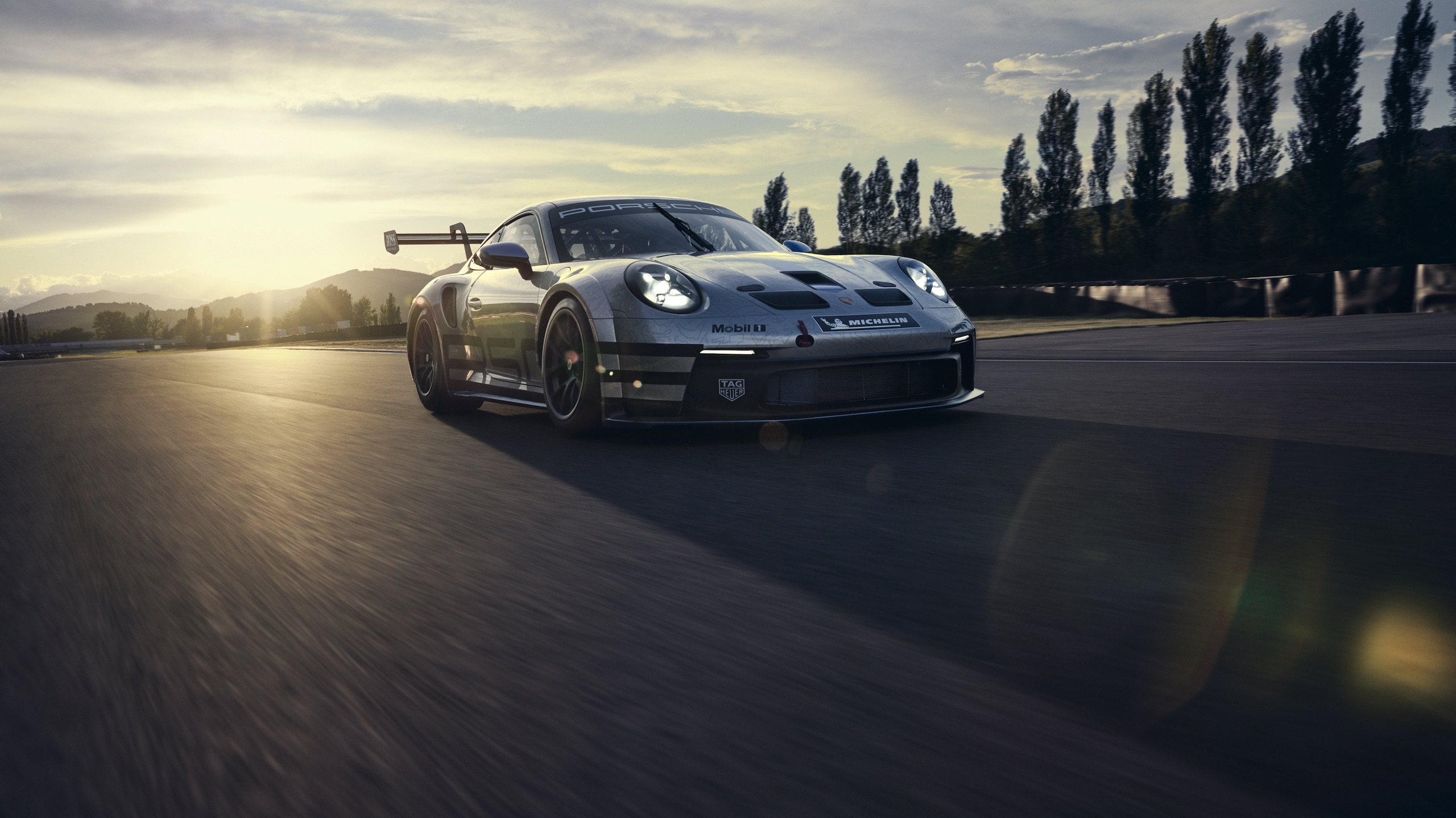 Porsche 911 GT3 front three-quarter dynamic track action