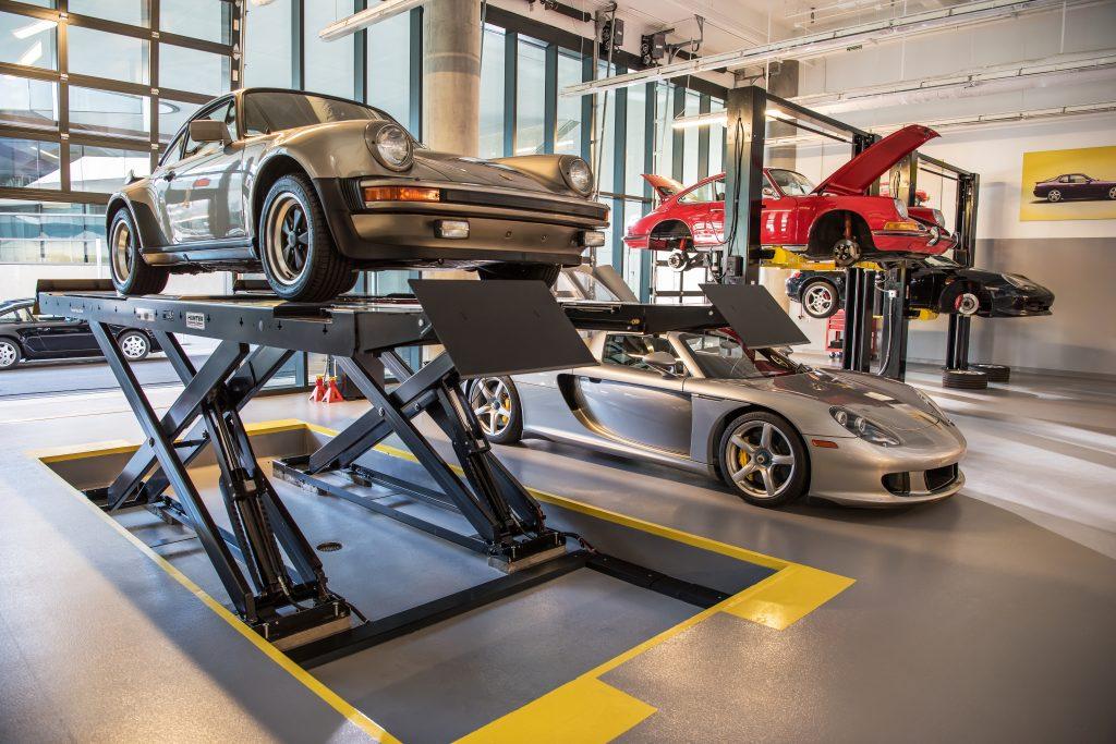 Porsche Carrera GT on lift front three-quarter