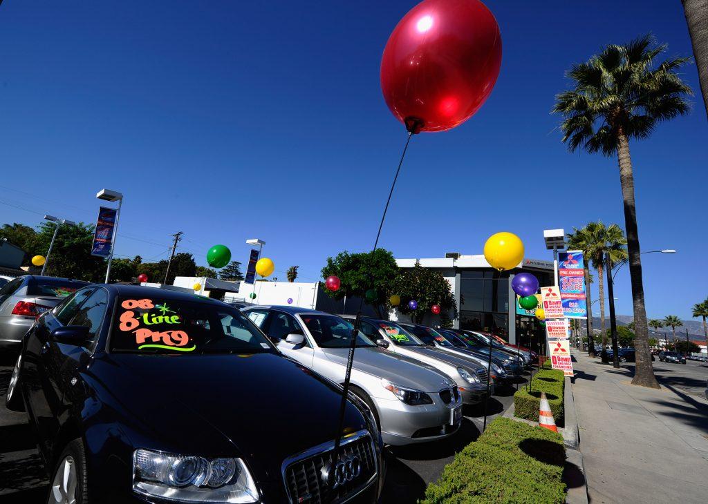 Used car dealership sales lot baloons