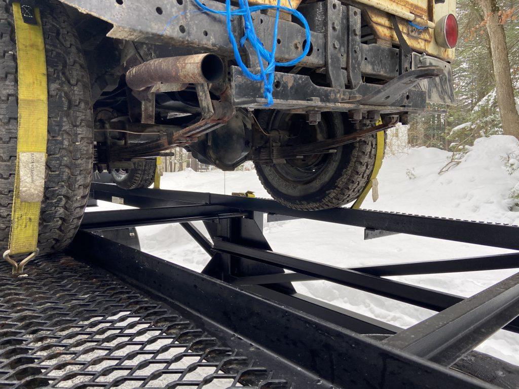 vintage jeep tire on trailer edge