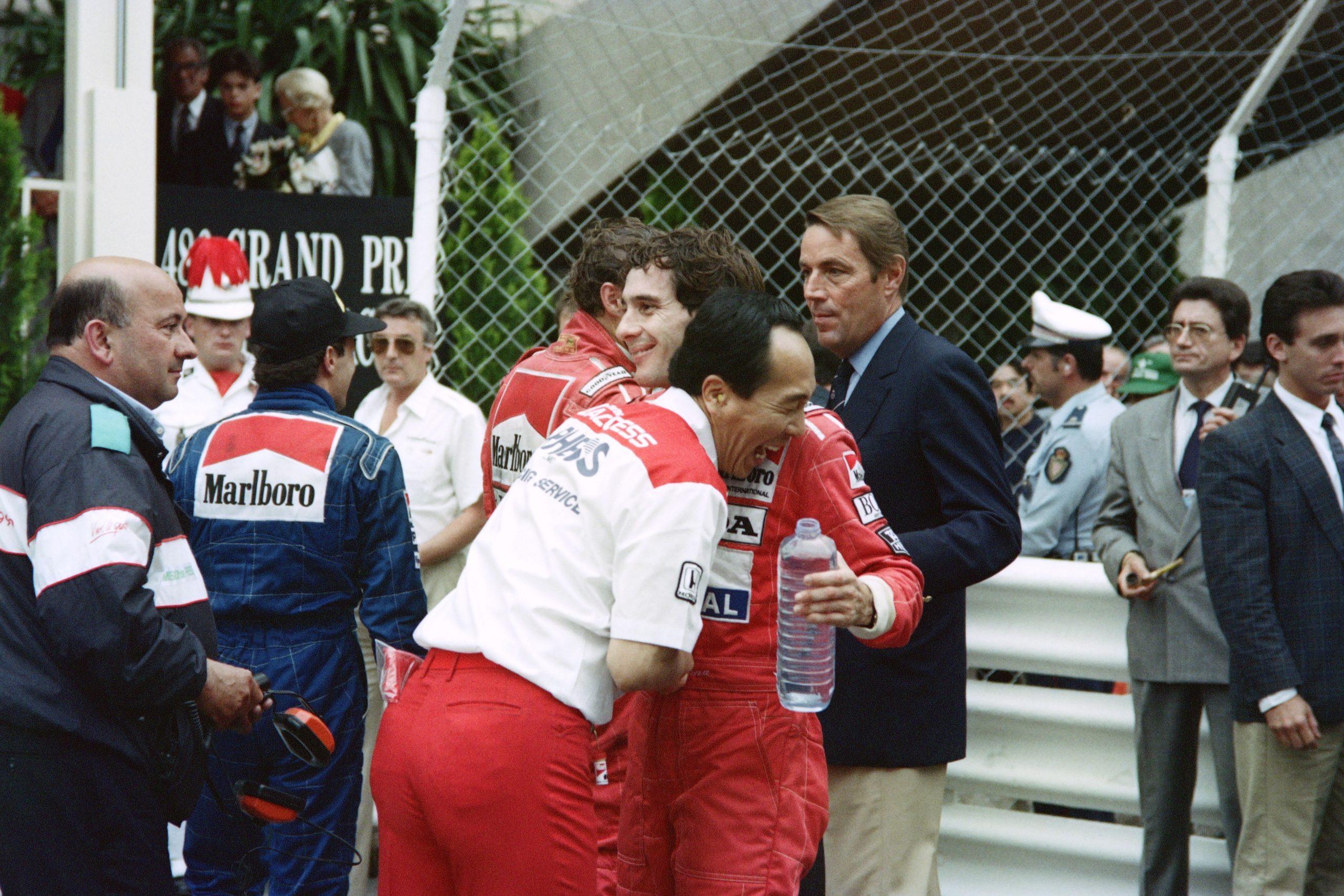 McLaren team member embraces Brazilian driver Ayrton Senna