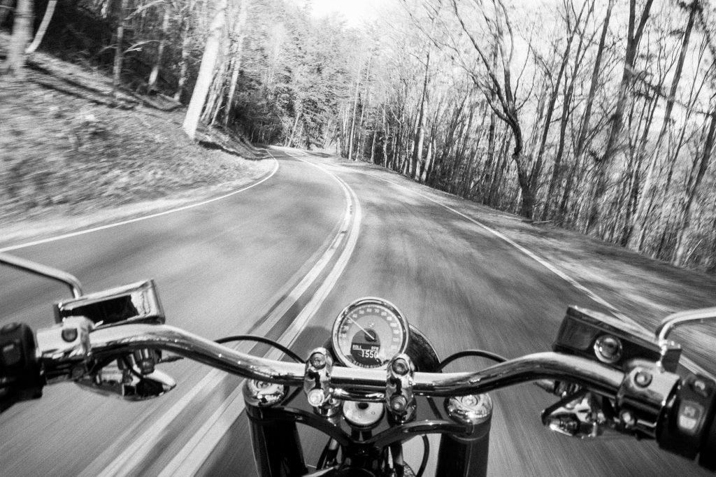 BMW R 18 motorcycle handlebar riding action black white