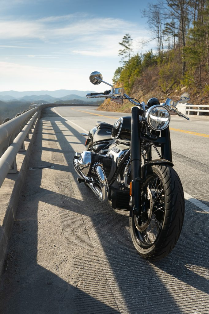 BMW R 18 motorcycle parked roadside front three-quarter