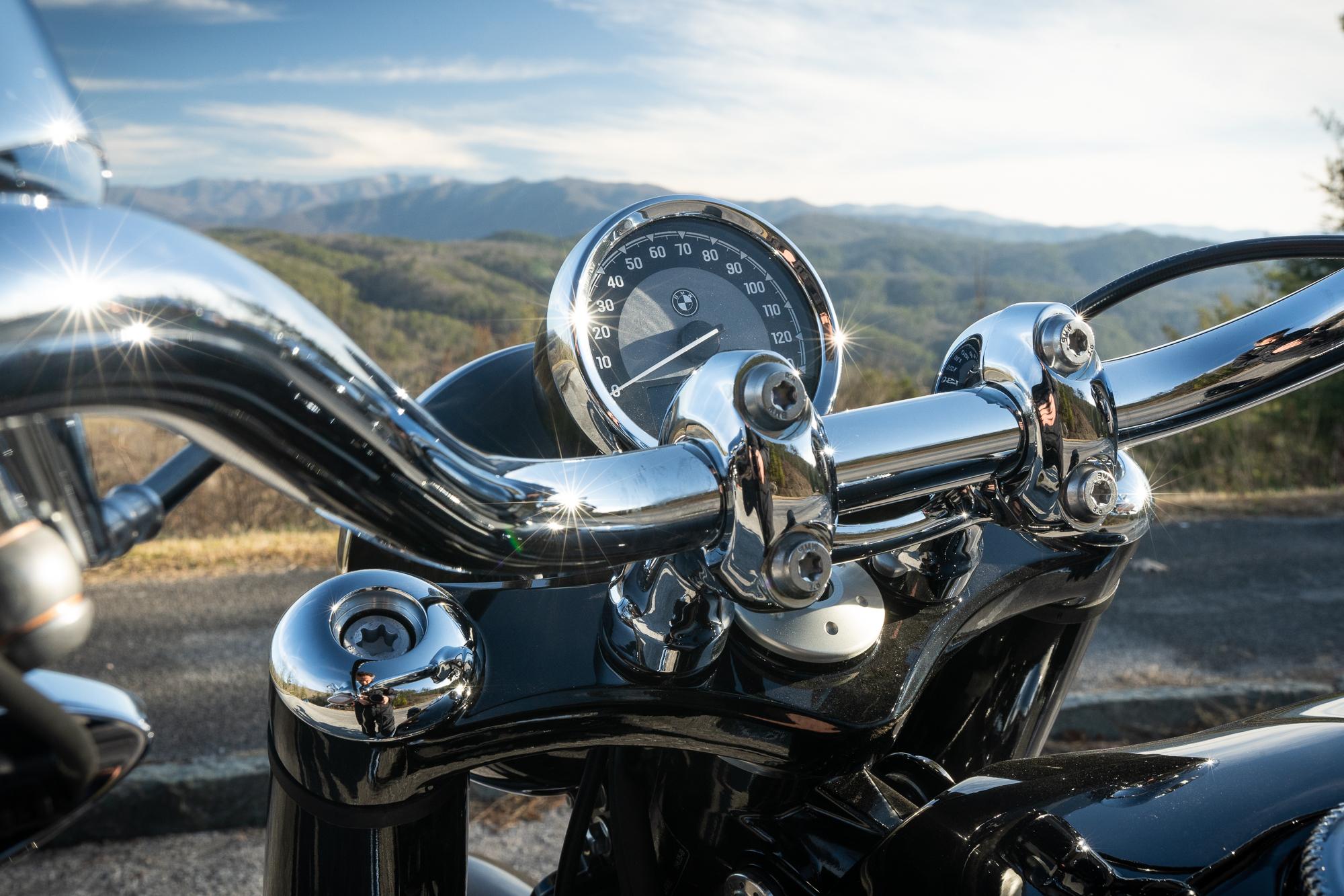 BMW R 18 motorcycle speedometer gauge detail mountain backdrop