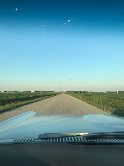 GTO convertible down open road