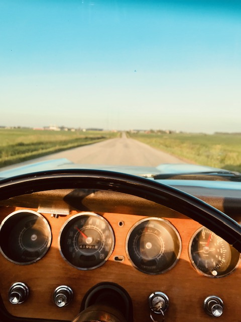 GTO convertible gauges down open road