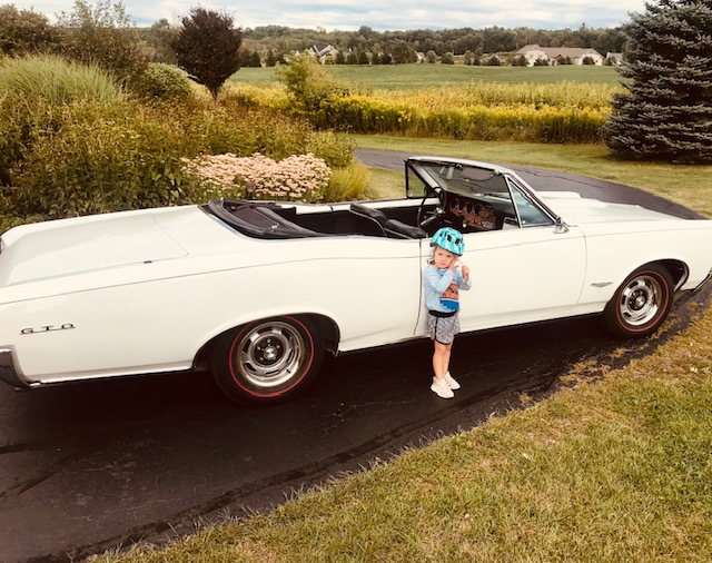 GTO convertible and child