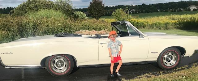 GTO convertible and kid