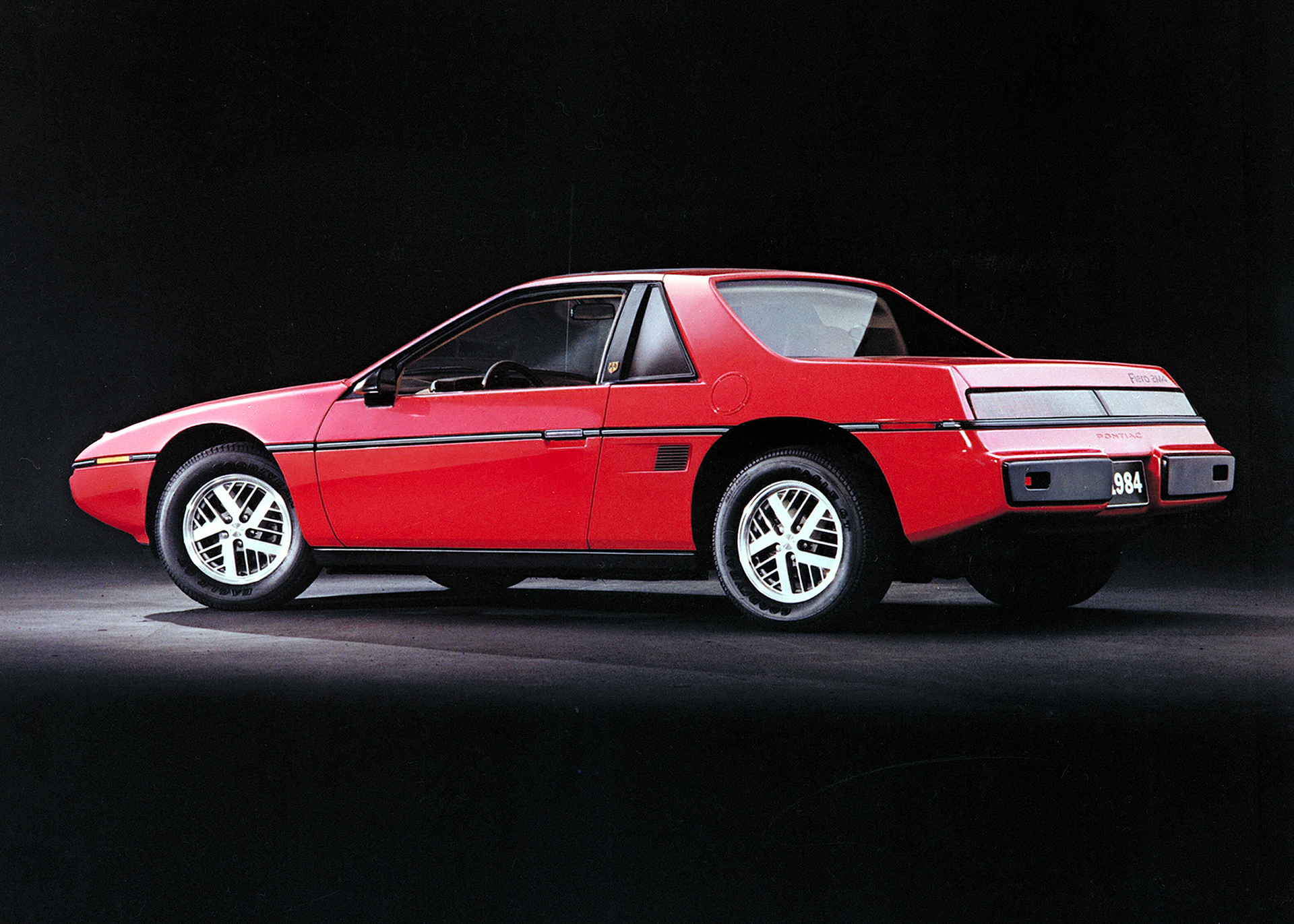 84 Fiero coupe rear three-quarter