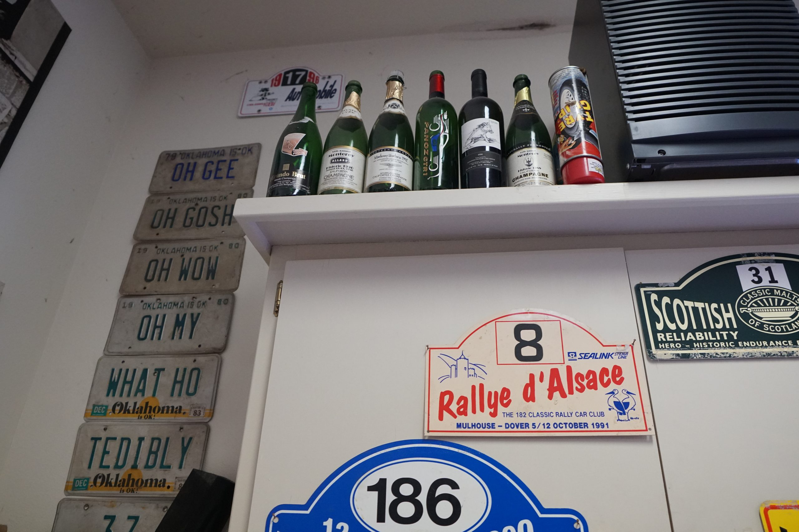 toly arutunoff garage license plates oh gee champagne bottles