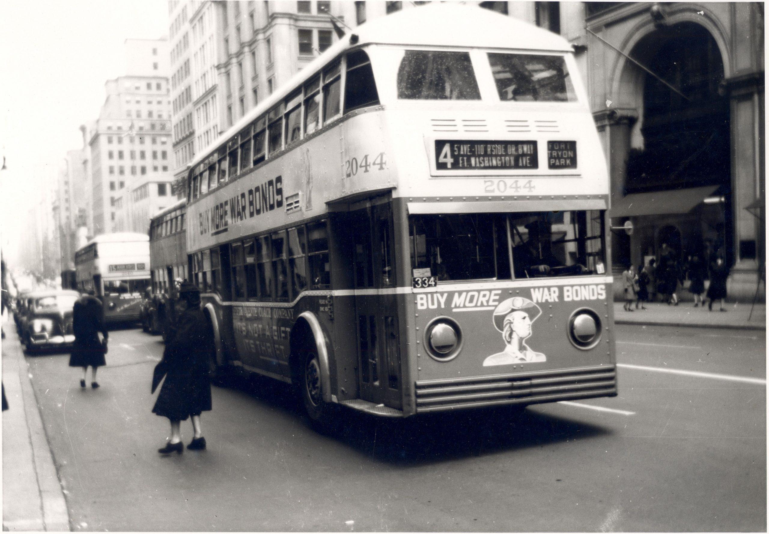 double decker bus advertises war bonds on fifth avenue