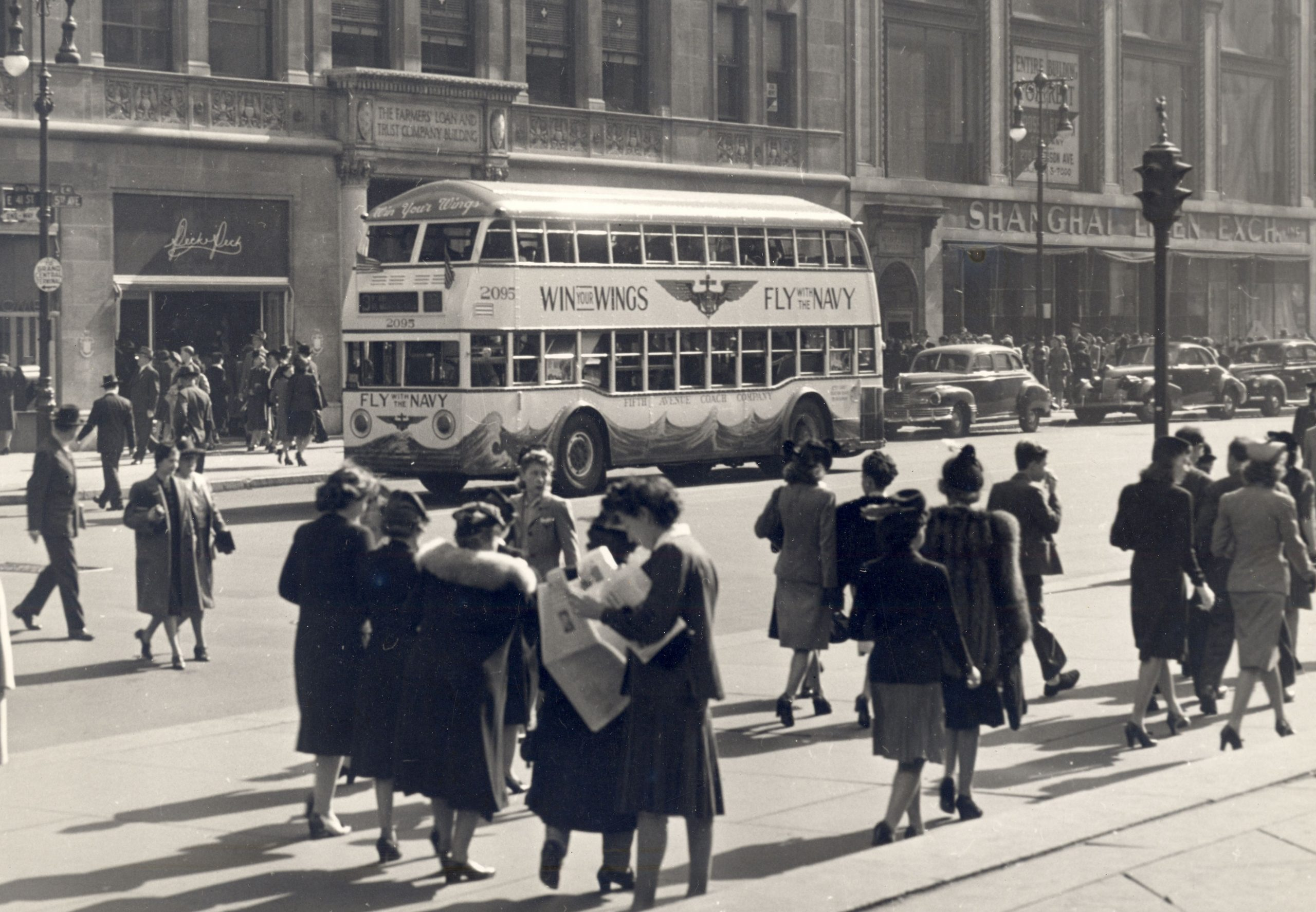 double decker bus fly with the navy ad